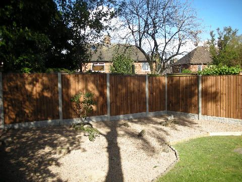 Graveled garden with wooden fence: Swipe To View More Images