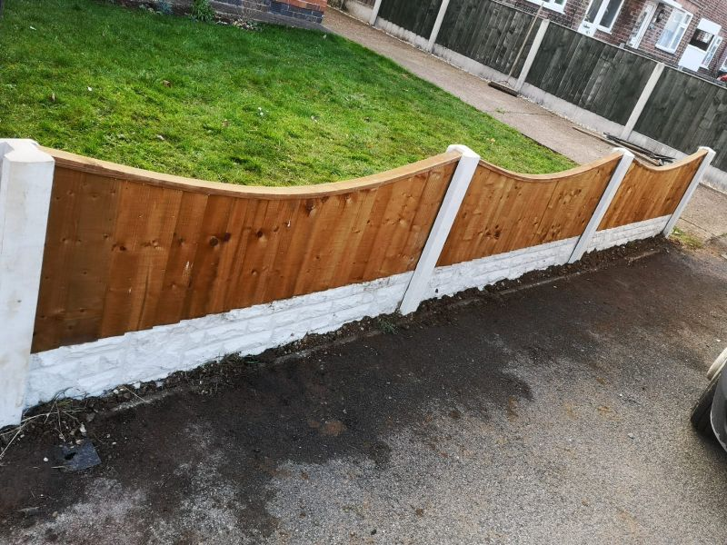 Concave solid wood panels with concrete post and concrete gravel boards: Swipe To View More Images