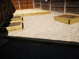 Decking, gravel and planters