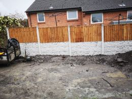 Fencing with retaining wall
