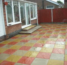 Multi coloured slabbed patio: Click Here To View Larger Image
