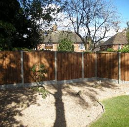Graveled garden with wooden fence: Click Here To View Larger Image