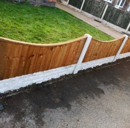 Concave solid wood panels with concrete post and concrete gravel boards: Click Here To View Larger Image
